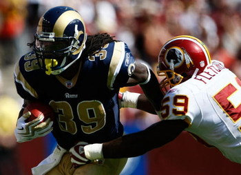 LANDOVER, MD - SEPTEMBER 20:  Steven Jackson #39 of the St. Louis Rams is tackled by London Fletcher #59 of the Washington Redskins during their game on September 20, 2009 at FedEx Field in Landover, Maryland.  The Redskins defeated the Rams by a score of