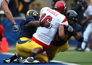 BERKELEY, CA - SEPTEMBER 12:  Eddie Young #9 and Tyson Aluala #44 of the California Golden Bears sack Matt Nichols #16 of the Eastern Washington Eagles at Memorial Stadium on September 12, 2009 in Berkeley, California.  (Photo by Jed Jacobsohn/Getty Image