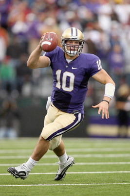 SEATTLE - SEPTEMBER 19:  Quarterback Jake Locker #10 of the Washington Huskies looks to pass the ball against the USC Trojans on September 19, 2009 at Husky Stadium in Seattle, Washington. The Huskies defeated the Trojans 16-13. (Photo by Otto Greule Jr/G