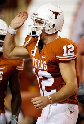 AUSTIN, TX - SEPTEMBER 19:  Quarterback Colt McCoy #12 of the Texas Longhorns celebrates a touchdown against the Texas Tech Red Raiders at Darrell K Royal-Texas Memorial Stadium on September 19, 2009 in Austin, Texas.  (Photo by Ronald Martinez/Getty Imag