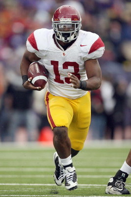 SEATTLE - SEPTEMBER 19:  Stafon Johnson #13 of the USC Trojans carries the ball during the game against the Washington Huskies on September 19, 2009 at Husky Stadium in Seattle, Washington. The Huskies defeated the Trojans 16-13. (Photo by Otto Greule Jr/