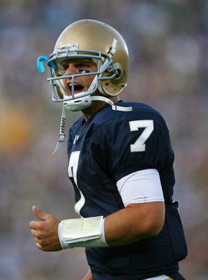 SOUTH BEND, IN - SEPTEMBER 19: Jimmy Clausen #7 of the Notre Dame Fighting Irish celebrates a touchdown pass against the Michigan State Spartans on September 19, 2009 at Notre Dame Stadium in South Bend, Indiana. Notre Dame defeated Michigan State 33-30. 
