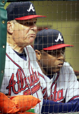 HOUSTON - OCTOBER 8:  Manager Bobby Cox #6 (L) and coach Terry Pendleton #9 of the Atlanta Braves watch the final inning from the dugout against the Houston Astros in Game Three of the 2005 National League Division Series on October 8, 2005 at Minute Maid