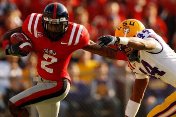 BATON ROUGE, LA - NOVEMBER 22:  Mike Wallace #2 of the Ole Miss Rebels avoids a tackle by Danny McCray #44 of the Louisiana State University Tigers  on November 22, 2008 at Tiger Stadium in Baton Rouge, Louisiana.  (Photo by Chris Graythen/Getty Images)