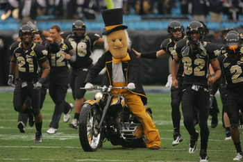 CHARLOTTE, NC - DECEMBER 29:  The mascot of the Wake Forest Demon Deacons rides a motorcycle onto the field to entertain the crowd during the game against the Connecticut Huskies at Bank of America Stadium on December 29, 2007 in Charlotte, North Carolina