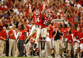 ATHENS, GA - SEPTEMBER 12:  Quarterback Joe Cox #14 and Tavarres King #12 celebrate a touchdown against the Georgia Bulldogs of the South Carolina Gamecocks at Sanford Stadium on September 12, 2009 in Athens, Georgia.  (Photo by Kevin C. Cox/Getty Images)