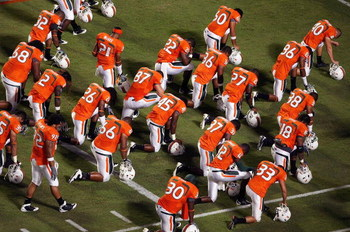 FORT LAUDERDALE, FL - SEPTEMBER 17:  The Miami Hurricanes say a prayer in the end-zone before taking on the Georgia Tech Yellow Jackets at Land Shark Stadium on September 17, 2009 in Fort Lauderdale, Florida. Miami defeated Georgia Tech 33-17.  (Photo by