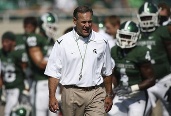 EAST LANSING, MI - SEPTEMBER 05:  Michigan State Spartans head coach Mark Dantonio watches the action during the game against the Montana State Bobcats on September 5, 2009 at Spartan Stadium in East Lansing, Michigan.  (Photo by Leon Halip/Getty Images)