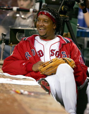 BOSTON - OCTOBER 8:   Pedro Martinez #45 of the Boston Red Sox looks on from the dugout in the seventh inning against the Anaheim Angels in Game 3 of the American League Division Series October 8, 2004 at Fenway Park in Boston, Massachusetts.  (Photo by A