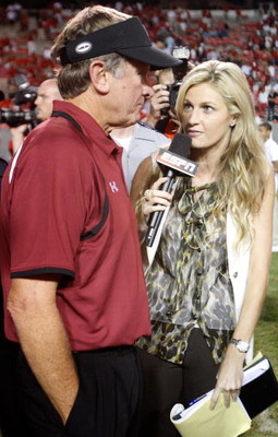 RALEIGH, NC - SEPTEMBER 03:  ESPN sideline reporter Erin Andrews interviews head coach Steve Spurrier of the South Carolina Gamecocks after their game against the North Carolina State Wolfpack at Carter-Finley Stadium on September 3, 2009 in Raleigh, Nort