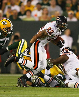 GREEN BAY, WI - SEPTEMBER 13: Matt Forte #22 of the Chicago Bears tries to gain yardage against the Green Bay Packers on September 13, 2009 at Lambeau Field in Green Bay, Wisconsin. The Packers defeated the Bears 21-15. (Photo by Jonathan Daniel/Getty Ima