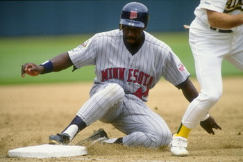 1991:  Chili Davis of the Minnesota Twins slides into a base during a game against the Oakland Athletics. Mandatory Credit: Otto Greule Jr.  /Allsport