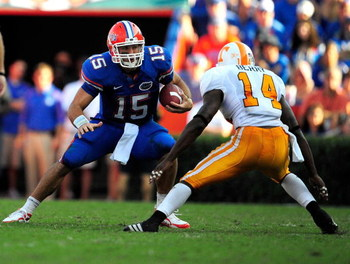 GAINESVILLE, FL - SEPTEMBER 19:  Tim Tebow #15 of the Florida Gators is cornered by Eric Berry #14 of the Tennessee Volunteers during the game at Ben Hill Griffin Stadium on September 19, 2009 in Gainesville, Florida.  (Photo by Sam Greenwood/Getty Images