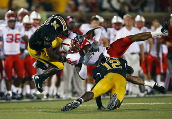 COLUMBIA, MO - OCTOBER 6:  Maurice Purify #16 of the Nebraska Cornhuskers is upended by Sean Weatherspoon #12 and Justin Garrett #8 of the Missouri Tigers during 2nd-half action on October 6, 2007 at Faurot Field in Columbia, Missouri.  Missouri won 41-6.