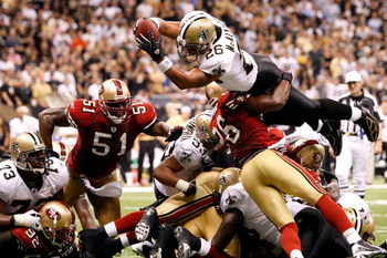 NEW ORLEANS - SEPTEMBER 28:  Deuce McAllister #26 of the New Orleans Saints scores a touchdown over Mark Roman #26 of the San Francisco 49ers on September 28 2008 at the Superdome in New Orleans, Louisiana.  The Saints defeated the 49ers 31-17.  (Photo by
