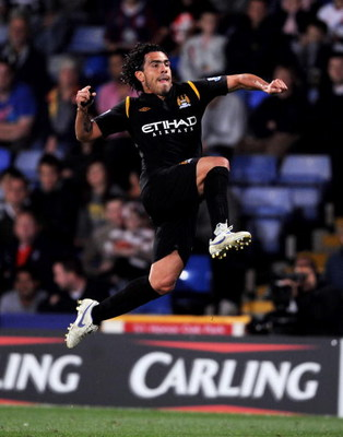 LONDON, ENGLAND - AUGUST 27:  Carlos Tevez of Manchester City celebrates after scoring during the Carling Cup second round match between Crystal Palace and Manchester City at Selhurst Park on August 27, 2009 in London, England.  (Photo by Shaun Botterill/