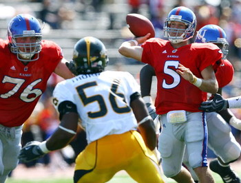 LAWRENCE, KS - SEPTEMBER 26:  Quarterback Todd Reesing #5 of the Kansas Jayhawks passes during the game against the Southern Mississippi Golden Eagles on September 26, 2009 at Memorial Stadium in Lawrence, Kansas.  (Photo by Jamie Squire/Getty Images)