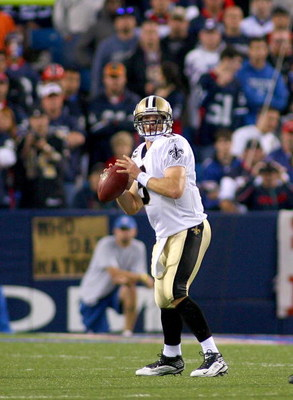 ORCHARD PARK, NY - SEPTEMBER 27:  Drew Brees #9 of the New Orleans Saints readies to pass against the Buffalo Bills at Ralph Wilson Stadium on September 27, 2009 in Orchard Park, New York. The Saints won 27-7.  (Photo by Rick Stewart/Getty Images)