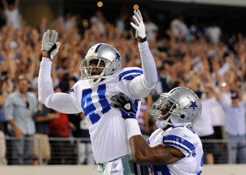ARLINGTON, TX - SEPTEMBER 28:  Terence Newman #41 of the Dallas Cowboys celebrates with teammate Ken Hamlin #26 after returning an interception for a touchdown in the fourth quater against the Carolina Panthers at Cowboys Stadium on September 28, 2009 in