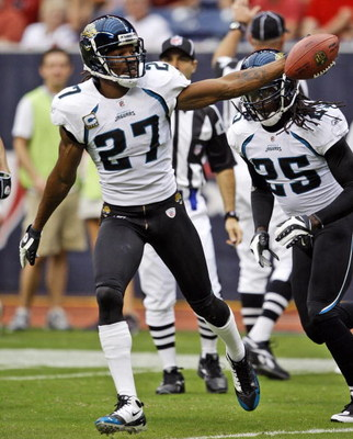 HOUSTON - SEPTEMBER 27:  Cornerback Rasheem Mathis #27 of the Jacksonville Jaguars celebrates with safety Reggie Nelson after intercepting a pass meant for  wide receiver Andre Johnson #80 of the Houston Texans at Reliant Stadium on September 27, 2009 in