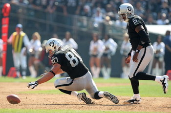 OAKLAND, CA - SEPTEMBER 27:  Zach Miller #80 of the Oakland Raiders recovers a fumble as JaMarcus Russell #2 looks on against the Denver Broncos on September 27, 2009 during an NFL game at the Oakland-Alameda County Coliseum in Oakland, California.  (Phot