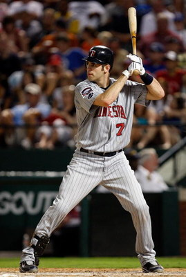 ARLINGTON, TX - JULY 17:  Catcher Joe Mauer #7 of the Minnesota Twins on July 17, 2009 at Rangers Ballpark in Arlington, Texas.  (Photo by Ronald Martinez/Getty Images)