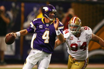 MINNEAPOLIS - SEPTEMBER 27: Brett Favre #4 of the Minnesota Vikings is chased out of the pocket by Pat Williams #94 of the San Francisco 49ers at the Hubert H. Humphrey Metrodome on September 27, 2009 in Minneapolis, Minnesota. (Photo by Jonathan Daniel/G