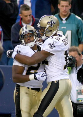 ORCHARD PARK, NY - SEPTEMBER 27: Pierre Thomas #23 and Marques Colston #12 of the New Orleans Saints celebrate Thomas' touchdown in the fourth quarter against the Buffalo Bills at Ralph Wilson Stadium on September 27, 2009 in Orchard Park, New York. The S