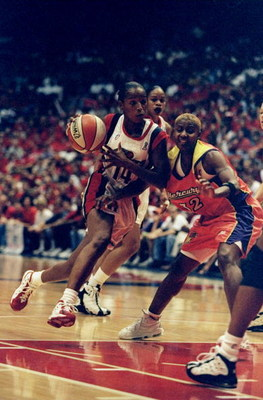 1 Sep 1998:  Guard Cynthia Cooper #14 of the Houston Comets in action against guard Bridget Pettis #32 of the Phoenix Mercury during game three of the WNBA Finals at the Compaq Center in Houston, Texas. The Comets defeated the Mercury 80-71. Mandatory Cre