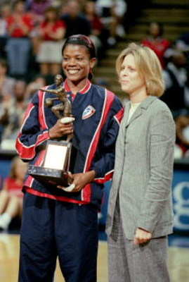 17 Aug 2000:  Sheryl Swoops #22 of the Houston Comets poses with her trophy and WNBA President Val Ackerman after the WNBA Playoff Game 1 against the  Los Angeles Sparks at the Compaq Center in Houston, Texas.  The Comets defeated the Sparks 77-56.  NOTE