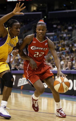 LOS ANGELES - AUGUST 25:  Sheryl Swoopes #22 of the Houston Comets drives to the basket past Mwadi Mabika#4 of the Los Angeles Sparks on August 25, 2003 at Staples Center in Los Angeles, California.  The Sparks won 67-84.  NOTE TO USER: User expressly ack