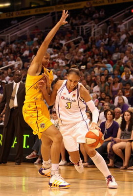 PHOENIX - SEPTEMBER 25:  Diana Taurasi #3 of the Phoenix Mercury drives the ball past Candace Parker #3 of the Los Angeles Sparks in Game Two of the Western Conference Finals during the 2009 WNBA Playoffs at US Airways Center on August 21, 2009 in Phoenix