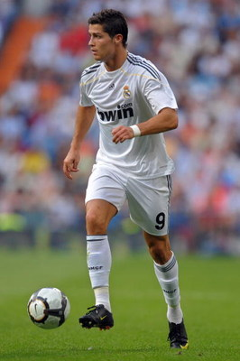 MADRID, SPAIN - SEPTEMBER 26:  Cristiano Ronaldo of Real Madrid controls the ball during the La Liga match between Real Madrid and Tenerife at the Estadio Santiago Bernabeu on September 26, 2009 in Madrid, Spain. Real Madrid won the match 3-0.  (Photo by