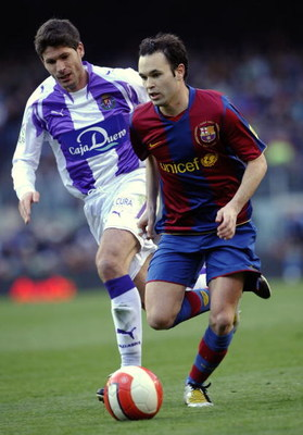 BARCELONA, SPAIN - MARCH 23: Andres Iniesta (R) of Barcelona and Vivar Dorado of Valladolid in action during the La Liga match between Barcelona and Valladolid at the Camp Nou stadium on March 23, 2008 in Barcelona, Spain.  (Photo by Manuel Queimadelos Al