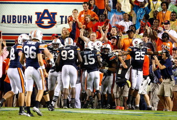 AUBURN, AL - SEPTEMBER 19:  Craig Stevens #46 of the Auburn Tigers celebrates his interception return for a touchdown in the final minutes of their 41-30 win over the West Virginia Mountaineers at Jordan-Hare Stadium on September 19, 2009 in Auburn, Alaba