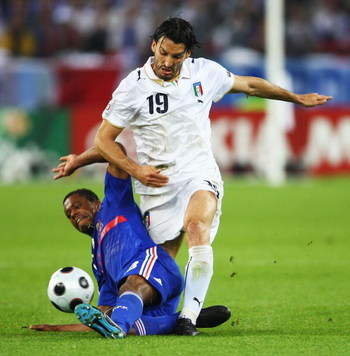 ZURICH, SWITZERLAND - JUNE 17:  Patrice Evra of France challenges Gianluca Zambrotta of Italy during the UEFA EURO 2008 Group C match between France and Italy at Letzigrund Stadion on June 17, 2008 in Zurich, Switzerland.  (Photo by Phil Cole/Getty Images