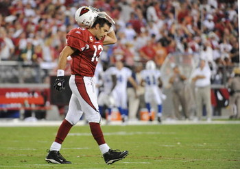 GLENDALE, AZ - SEPTEMBER 27:  Quarterback Kurt Warner #13 of the Arizona Cardinals reacts at the end of the second quarter against the Indianapolis Colts during the game at University of Phoenix Stadium on September 27, 2009 in Glendale, Arizona. (Photo b