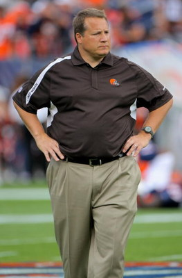 DENVER - SEPTEMBER 20:  Head coach Eric Mangini of the Cleveland Browns oversees warm ups prior to facing the Denver Broncos during NFL action at Invesco Field at Mile High on September 20, 2009 in Denver, Colorado.  (Photo by Doug Pensinger/Getty Images)