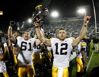 STATE COLLEGE, PA - SEPTEMBER 26:  Ricky Stanzi #12 of the Iowa Hawkeyes celebrates a 21-10 victory over the Penn State Nittnay Lions with Travis Meade #61 on September 26, 2009 at Beaver Stadium in State College, Pennsylvania.  (Photo by Gregory Shamus/G
