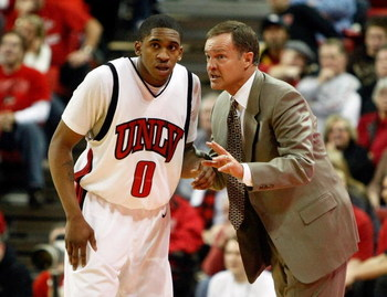 LAS VEGAS - JANUARY 03:  Head coach Lon Kruger of the UNLV Rebels talks to Oscar Bellfield #0 during a game against the New Mexico Lobos at the Thomas & Mack Center January 3, 2009 in Las Vegas, Nevada. The Rebels won 60-58.  (Photo by Ethan Miller/Getty
