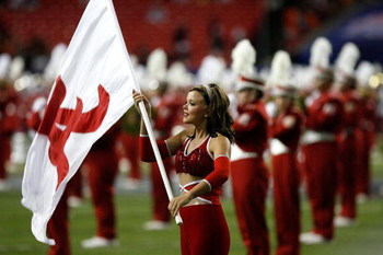 ATLANTA - SEPTEMBER 05:  A flag girl for the Alabama Crimson Tide marching band performs before the game against the Virginia Tech Hokies during the Chick-fil-A Kickoff Game at Georgia Dome on September 5, 2009 in Atlanta, Georgia.  (Photo by Kevin C. Cox