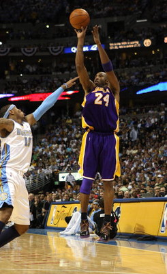 DENVER - MAY 25:  Kobe Bryant #24 of the Los Angeles Lakers shoots against Carmelo Anthony #15 of the Denver Nuggets in Game Four of the Western Conference Finals during the 2009 NBA Playoffs at Pepsi Center on May 25, 2009 in Denver, Colorado. NOTE TO US