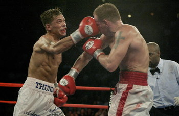 ATLANTIC CITY, NJ - JUNE 7:  Arturo Gatti lands a right to Micky Ward during their Junior Welterweight bout at Boardwalk Hall on June 7, 2003 in Atlantic City, New Jersey. Gatti won a unanimous decision. (Photo by Al Bello/Getty Images)