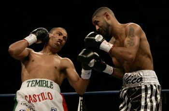 LAS VEGAS - OCTOBER 08:  Jose Luis Castillo of Mexico throws a left upper cut against Diego 'Chico' Corrales during their Bout October 8, 2005 at the Thomas & Mack Center on the campus of UNLV in Las Vegas, Nevada. Castillo won by knockout in the 4th roun