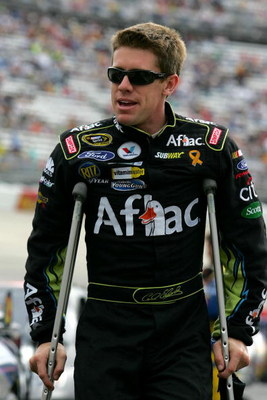 DOVER, DE - SEPTEMBER 27:  Carl Edwards, driver of the #99 Aflac Ford, walks on crutches to his car before the NASCAR Sprint Cup Series AAA 400 at Dover International Speedway on September 27, 2009 in Dover, Delaware.  (Photo by Todd Warshaw/Getty Images 