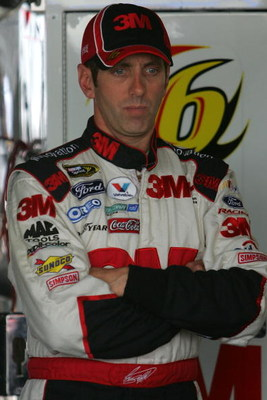 DOVER, DE - SEPTEMBER 26:  Greg Biffle, driver of the #16 3M Ford, stands in his car during practice for the NASCAR Sprint Cup Series AAA 400 at Dover International Speedway on September 26, 2009 in Dover, Delaware.  (Photo by Chris Trotman/Getty Images)