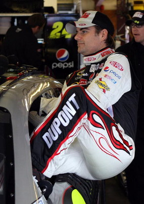 LOUDON, NH - SEPTEMBER 19:  Jeff Gordon, driver of the #24 DuPont/National Guard Yellow Ribbon Chevrolet, climbs into his car during practice for the NASCAR Sprint Cup Series Sylvania 300 at the New Hampshire Motor Speedway on September 19, 2009 in Loudon