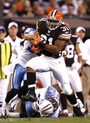 CLEVELAND - AUGUST 29:  Jamal Lewis #31 of the Cleveland Browns runs through the defense of the Tennessee Titans at Cleveland Browns Stadium on August 29, 2009 in Cleveland, Ohio.  (Photo by Matt Sullivan/Getty Images)