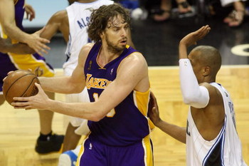ORLANDO, FL - JUNE 9:  Pau Gasol #16 of the Los Angeles Lakers looks to maneuver against Tony Battie #4 of the Orlando Magic in Game Three of the 2009 NBA Finals on June 9, 2009 at Amway Arena in Orlando, Florida.  The Magic won 108-104.  NOTE TO USER:  U