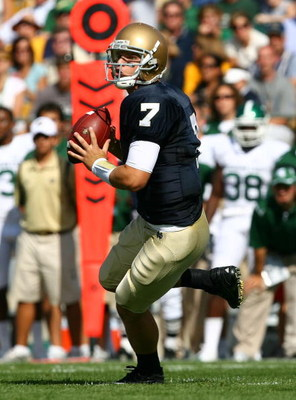 SOUTH BEND, IN - SEPTEMBER 19: Jimmy Clausen #7 of the Notre Dame Fighting Irish looks for a receiver against the Michigan State Spartans on September 19, 2009 at Notre Dame Stadium in South Bend, Indiana. Notre Dame defeated Michigan State 33-30. (Photo